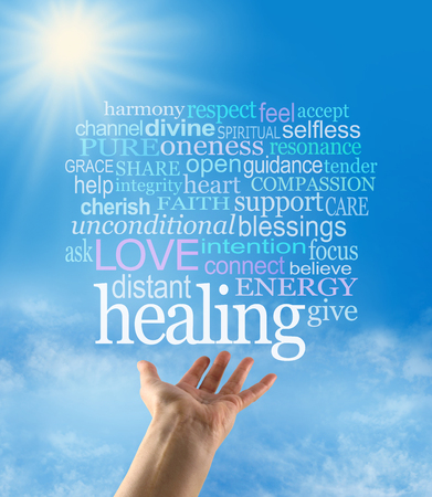 channeling: Sending out beautiful healing intention - female hand palm up with a large HEALING word floating above and a word cloud on a blue sky background with a sunburst and sun rays beaming down