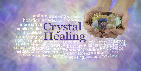 crystal healing: Crystal healing word cloud banner - female crystal therapist offering  a selection of crystals in a brass dish, surrounded by a relevant word cloud on an ethereal pastel colored background Stock Photo
