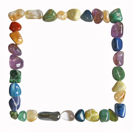 Square Crystal Border - A square of carefully arranged multi colored tumbled healing crystals isolated on a white background