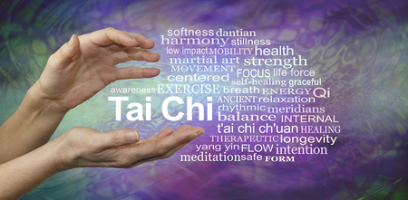 Tai Chi Benefits Word Cloud - female hands cupped around the words TAI CHI surrounded by a relevant word cloud on a purple and jade green patterned background Stock Photo