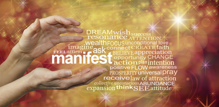 abundance: Manifest Your Dreams Word Cloud - female hands with the word MANIFEST floating between surrounded by a relevant word cloud on a warm golden swirling sparkling energy formation background Stock Photo