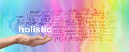 ホリスティック療法の単語の雲 - 女性手白上記虹に関連する単語の雲に囲まれた単語ホリスティック開催手のひら色の大理石の効果を背景 写真素材