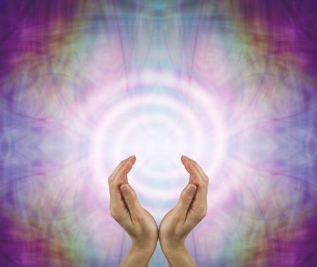 healer: Spiraling energy field - female hands sensing spiraling white energy on an intricate multicolored Eastern pattern background