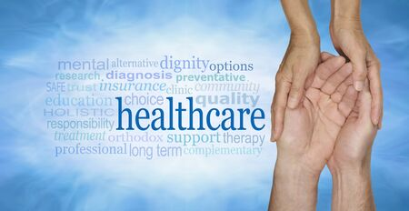 cradling: Healthcare Word Cloud - female hands gently cradling male hands on a pale misty blue vignette background with a healthcare word cloud to the left