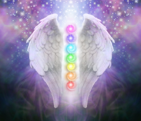 shaft: Angel Wings Chakras Darkness and Light - A pair of Angel wings with the seven chakras between with dark blue black and purple behind, a shaft of light and sparkles Stock Photo