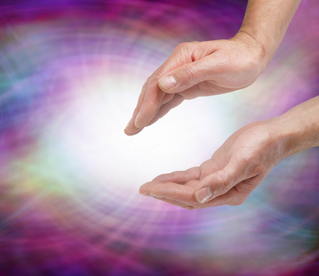 healers: Sensing Vortex Healing Energy  -   Male healers outstretched cupped hands sensing white energy orb surrounded by multicolored flowing energy Stock Photo