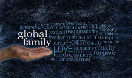 black blue: Global Family word cloud campaign banner - female hand palm up with white words GLOBAL FAMILY floating above surrounded by a relevant word cloud on a blue black rough rock effect background