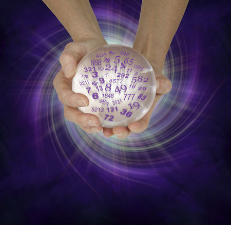 pseudoscience: What are your lucky numbers - female hands cupped around a large crystal ball with random numbers emerging  on a  purple black spiraling energy field background with copy space below