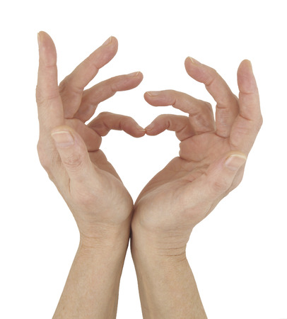 matchmaker: Simple Symbol of Love  - female hands touching together to make a heart symbol isolated on a white background