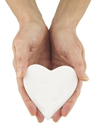 matchmaker: Write Your Message of Love - female hands holding a white blank heart ideal for a personal message on a white background