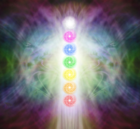 The Seven Chakra Vortexes in a Pranic Energy Field  - column of  seven chakras on a beautiful ethereal energy formation background Stock Photo