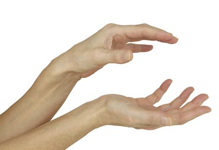 chi healer: Sensing the electromagnetic energy between hands - a pair of female hands demonstrating the position for sensing the bodys natural electromagnetic field isolated on a white background Stock Photo