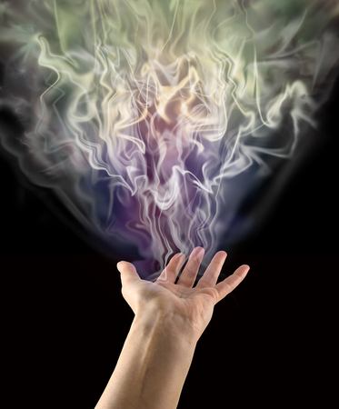 spiritualism: Visible Ectoplasm Activity - female hand palm up sensing a gaseous mass of ectoplasmic matter on a  black background with copy space