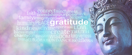 Gratitude Buddhism Word Cloud Banner -  Close up of blue grunge style Buddha head on wide pink blue bokeh background with a GRATITUDE word cloud on left side Stock Photo