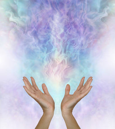 let out: Release and let go - female hands reaching up and out towards a  gaseous field of ectoplasmic matter on a turquoise blue purple background with copy space