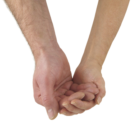 Supporting each other - a mature male hand cupped and cradled gently in a mature female cupped hand implying togetherness, isolated on a white background