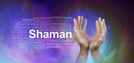 Male Hands Shaman word cloud banner  - male hands reaching up with the word SHAMAN beside   surrounded by a word cloud on a wide gaseous ethereal energy background Stock Photo