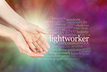 energy healing: The healing hands of a Lightworker  - Female hands in open gesture beside the word LIGHTWORKER and a relevant word cloud  on a radiating multi-coloured bokeh background
