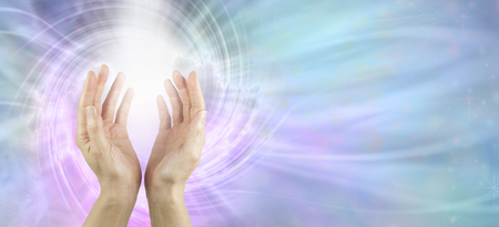 Channeling Vortex healing energy  - female hands reaching up with white vortex energy formation and pink blue ethereal energy field  background
