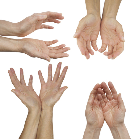 prana: The Hands of an Energy Healing Practitioner - female hands in four different cupped position isolated on a  background Stock Photo