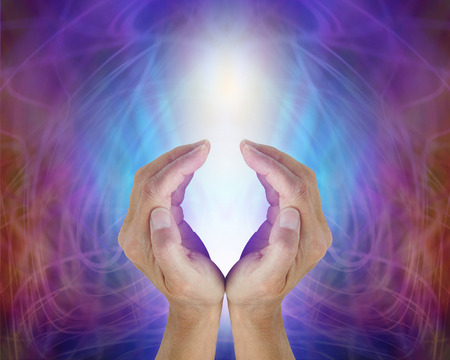 prana: Divine Light Sacred Source of All That Is - female cupped hands sensing the precious energy of All That Is, a glowing white light surrounded by an electric blue and magenta energy field