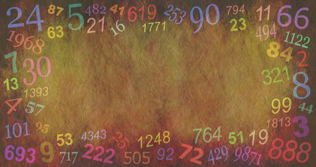 Numerology Numbers border background  -  random multicolored numbers creating a border on a stone effect rustic background with a central copy space Stock Photo