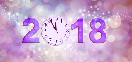 Nearly Happy New Year 2018 - a clock face showing 11.55 making the 0 of 2018 on a sparkling pink bokeh background Stock Photo