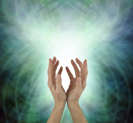 Beaming Beautiful Heart Chakra Healing Energy - female hands reaching upwards sending heart energy out against a green energy matrix formation background with copy space