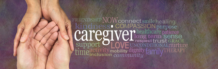 Caregivers Word Cloud - female hands gently cupped around male cupped hands beside a CAREGIVER word cloud on a rustic stone background Stock Photo - 91021649