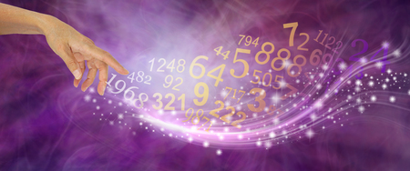 Numerology is far more than just NUMBERS - female hand appearing to create a swish of sparkles and a flow of random numbers on a pink purple energy formation background Stock Photo