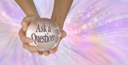 Go on - Ask me a Question - a female holding a large clear crystal ball with ASK A QUESTION within against a feminine pink swishing sparkling background with copy space