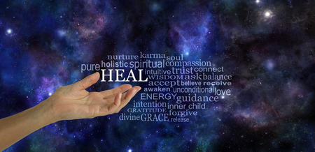 Heal Word Tag Cloud - female hand gesturing towards the word HEAL surrounded by a relevant word tag cloud on a dark blue deep space night sky background