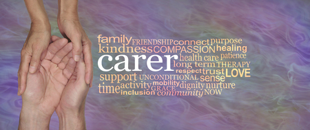 Carers Word Cloud - female hands gently cupped around male cupped hands beside a CARER word cloud on a flowing muted lilac  background 写真素材
