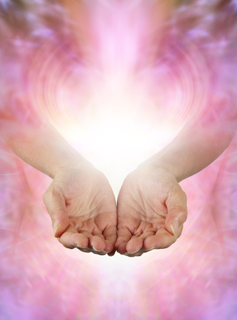Sharing Abundance Healing Energy with You - Female open cupped hands with vibrant white light and gentle pink energy field offering beautiful energy with copy space for your message
