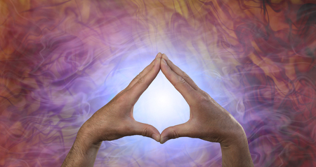 Quantum Healing Energy - male hands creating a leaf shape against a glowing blue light and flowing quantum healing energy field 스톡 콘텐츠