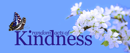 Random Acts of Kindness butterfly background - a blue background with white blossom on right and the words RANDOM ACTS OF KINDNESS and a butterfly  sitting on the K Stock Photo