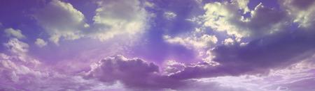 Dreamy Romantic Purple Cloudscape - beautiful wide purple and pink cloud scape Stock Photo