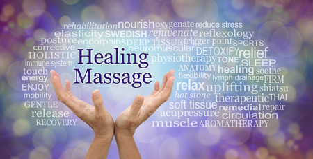 Healing Massage Word Cloud - female hands reaching up to the words HEALING MASSAGE surrounded by a relevant word cloud against a purple and gold bokeh background Stock Photo