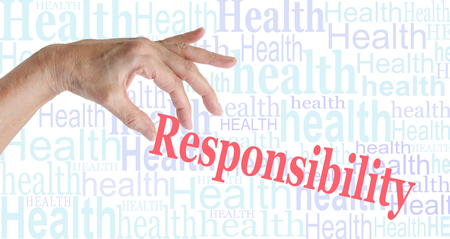 Take Responsibility for your HEALTH - female hand picking up the word RESPONSIBILITY against a background of randomly sized snug fitting words all saying HEALTH Stock Photo