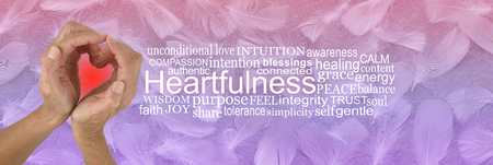 Heartfulness Hands Word Tag Cloud - female hands making a heart shape against a pink lilac random feather background with a HEARTFULNESS word cloud on right Stok Fotoğraf