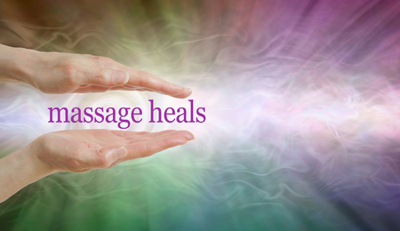 Massage HEALS so give it a try - parallel hands with the words MASSAGE HEALS floating between against a radiating multicoloured ethereal energy background and copy space
