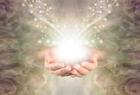 Sending You High Resonance Healing Energy - female cupped hands emerging from a green gold swirling energy field background with shimmering sparkles and white light flowing outwards