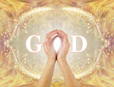I am connected to All That Is - I am the Light - female hands making the O of GOD on a golden glittering border background with swirling warm gold energy and an oval framework of symmetrical sparkles 版權商用圖片
