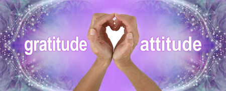 Purple Heart Hands Gratitude Attitude Banner  - female hands making a heart shape with the words GRATITUDE  ATTITUDE either side on a wide purple background with sparkling border 写真素材