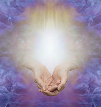 Sending You Unconditional Love Healing Energy -  cupped female hands emerging from golden energy field surrounded by a purple border with copy space above