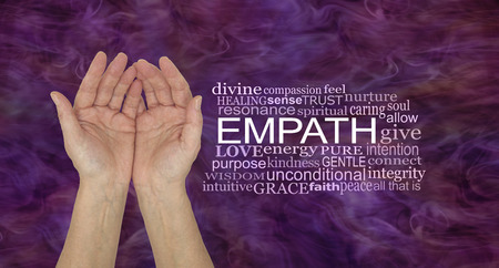 The healing hands of an empath - pair of female hands gently cupped beside an EMPATH word cloud against a deep purple pink energy background