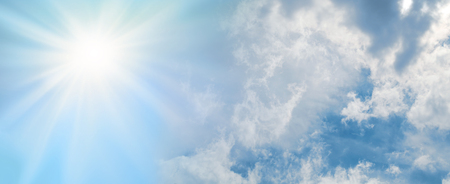 The sun is always shining behind the clouds - Bright sun burst breaking through big white fluffy clouds background