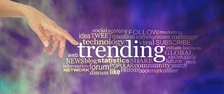 Lets take a look at whats trending concept word cloud - female hand point a finger at the word TRENDING surrounded by a word cloud against a modern purple abstract background Imagens