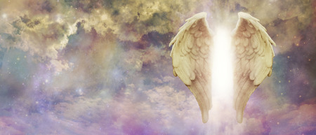 Guardian Angel Light Being Watching Over You - pair of golden Angel Wings with a bright light between against a colourful turbulent cloudscape with copy space Stockfoto