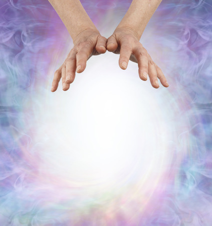 Energy Healers Message Background - female hands floating over a large spiraling ball of white energy providing space for your message